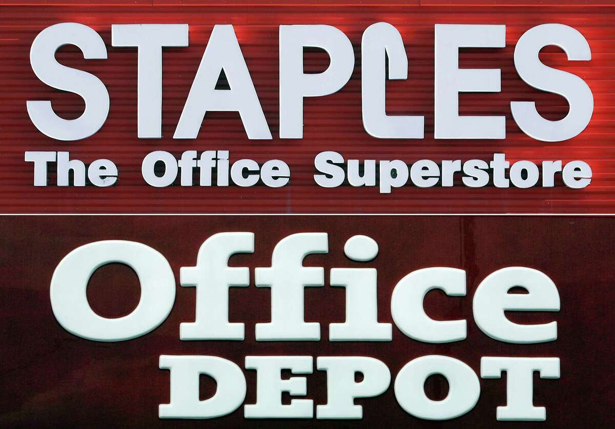 """This combination made with 2009 file photos shows signage for a Staples store in Springfield, Ill., top, and an Office Depot store in Miami Springs, Fla. A federal judge Tuesday, May 10, 2016, blocked the proposed merger of Staples and Office Depot, saying the government had made the case that the merger had a """"reasonable probability"""" of hurting competition in office supplies."""