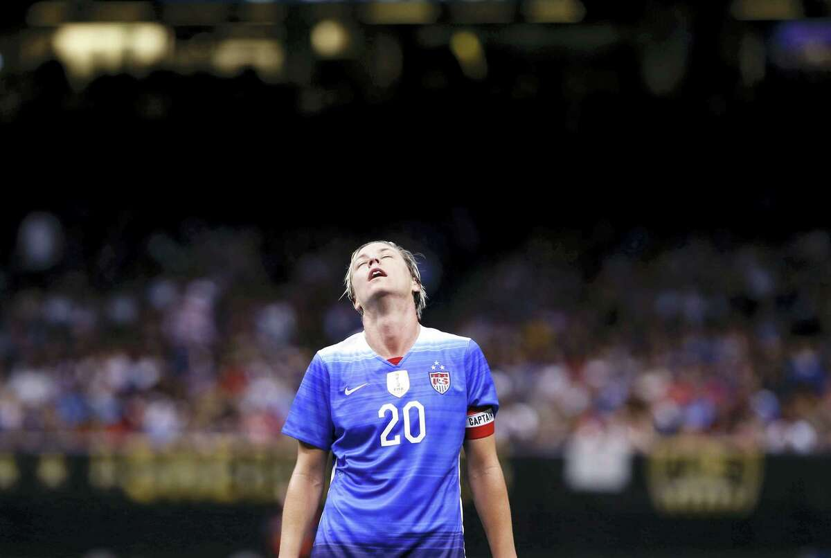 In this Dec. 16, 2015 photo, U.S. forward Abby Wambach reacts during the first half of an international friendly soccer match against China in New Orleans. Wambach says she abused alcohol and prescription drugs for years until her arrest for driving under the influence in April.