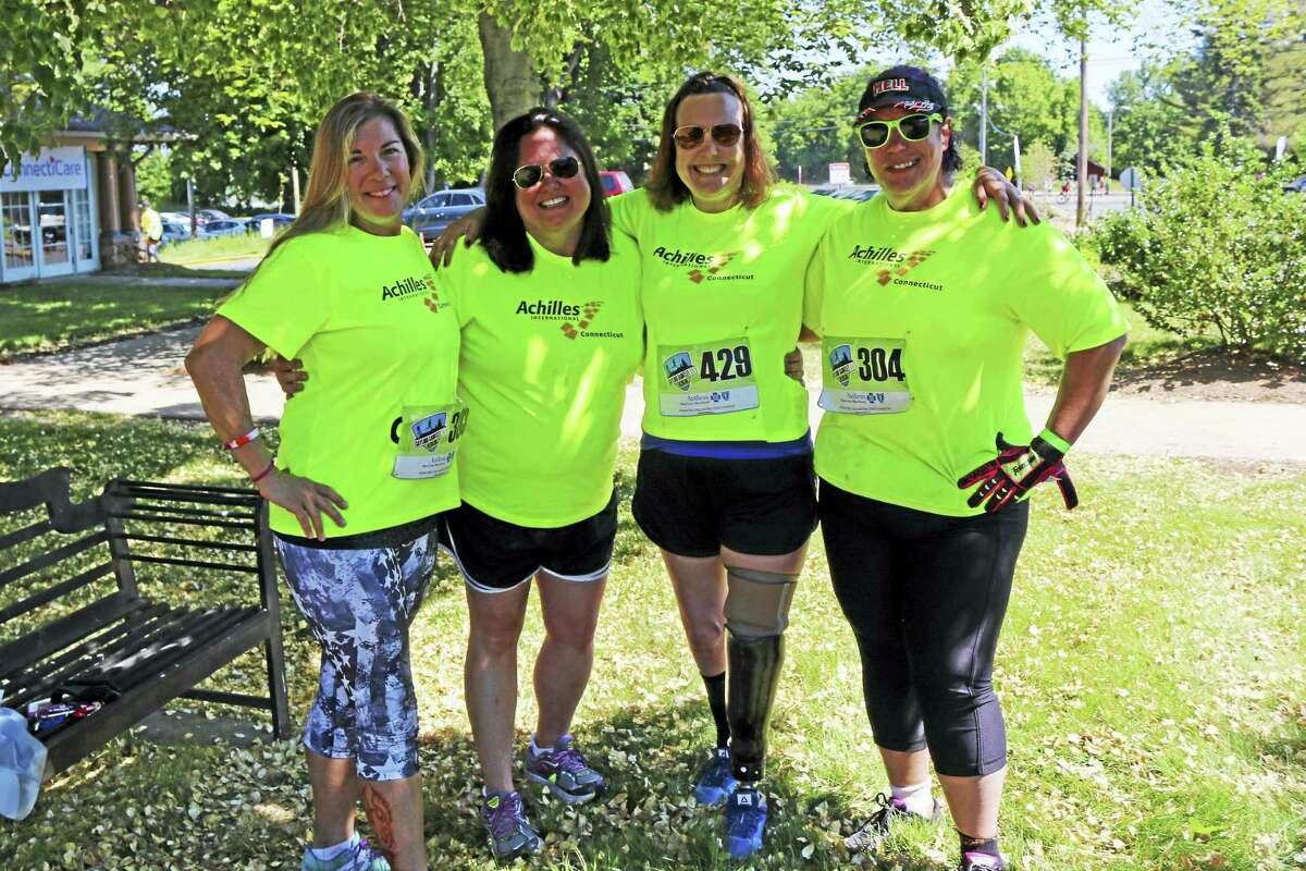 "From left are guide Elizabeth Hayward, Erin Spaulding (Achilles International Connecticut president), athlete Tara Frey and Margaret ""Grit"" Rorrio of East Hampton."