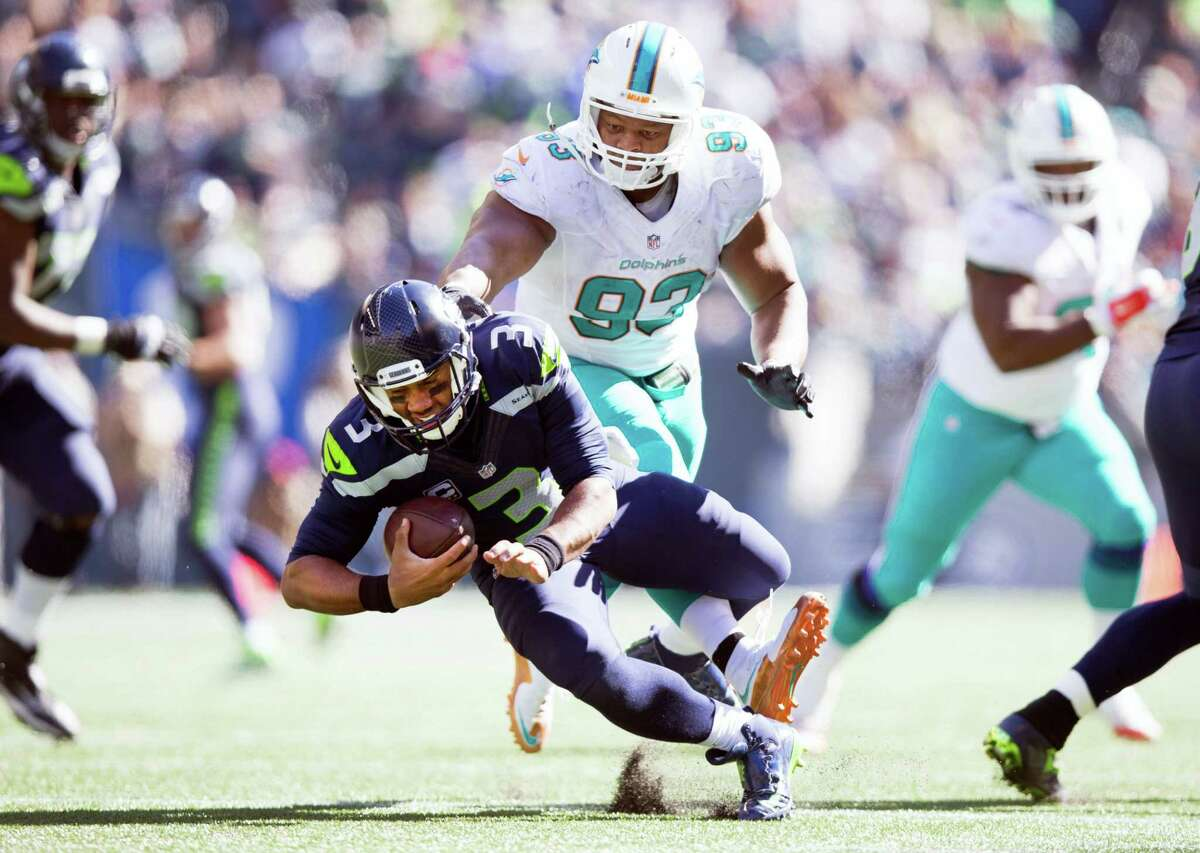 Miami Dolphins defensive tackle Ndamukong Suh (93) steps on Seattle Seahawks quarterback Russell Wilson's foot in the third quarter of an NFL football game in Seattle on Sept. 11, 2016.
