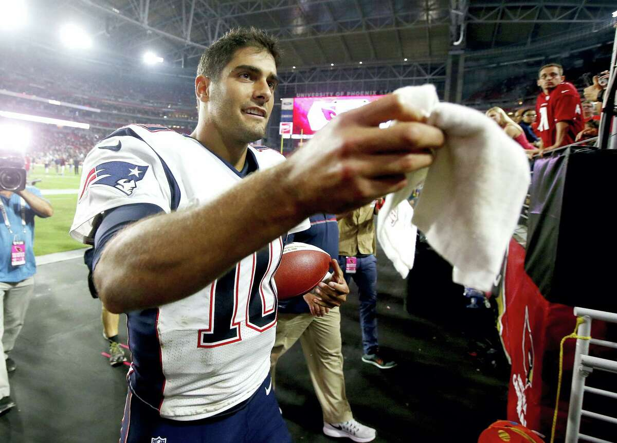 Patriots quarterback Jimmy Garoppolo leaves the field after Sunday's win over the Cardinals.