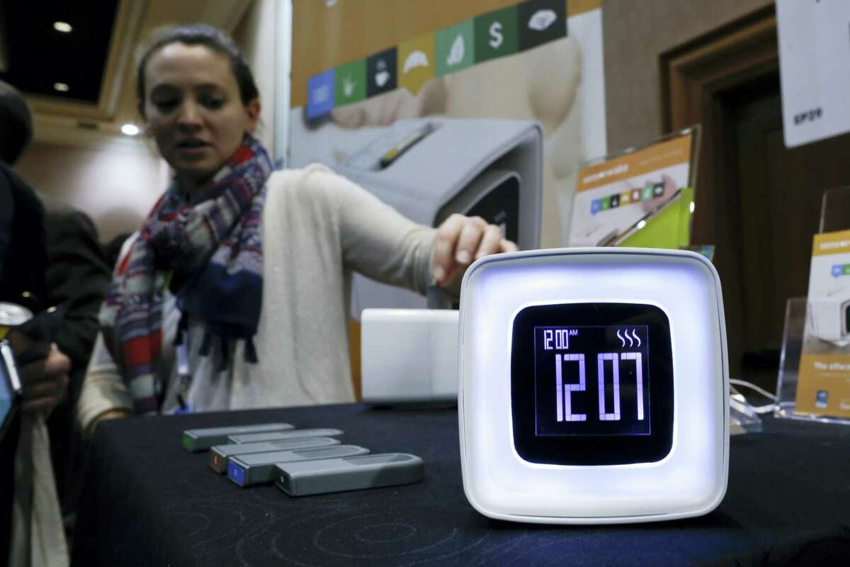 A Sensorwake olfactory alarm is displayed at CES Unveiled, a media preview event for CES International Monday, Jan. 4, 2016, in Las Vegas. The alarm uses fragrances as part of the alarm waking system.