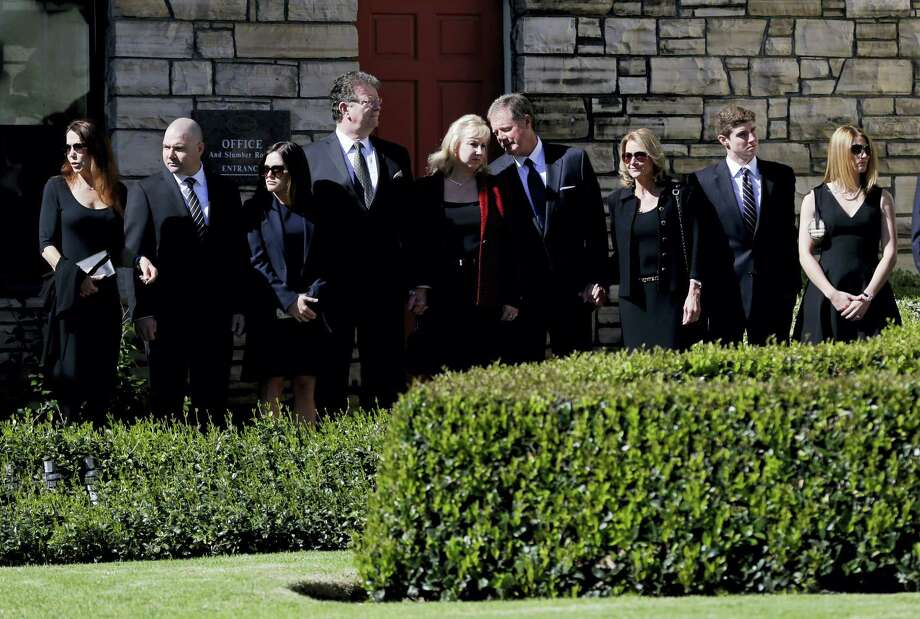 Family members watch as the casket carrying the former first lady Nancy Reagan leaves a small ceremony at a mortuary, Wednesday, March 9, 2016, in Santa Monica, Calif. Photo: AP Photo/Jae C. Hong, Pool   / Pool AP