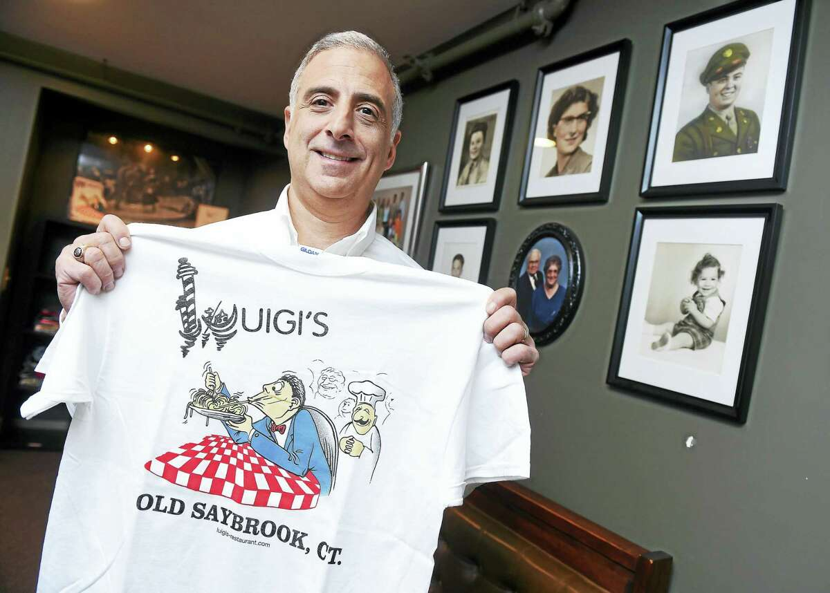 Len DiBella is photographed at Luigi's Restaurant in Old Saybrook.