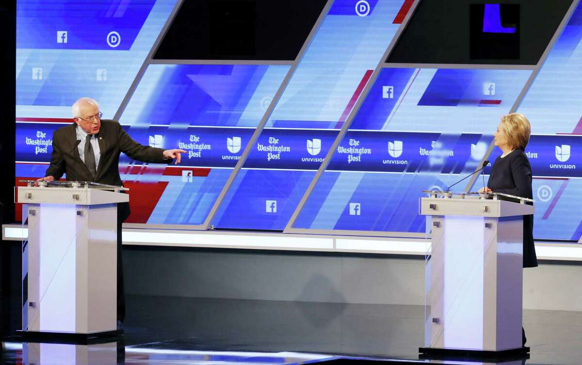 Democratic presidential candidate, Sen. Bernie Sanders, I-Vt, gestures towards Democratic presidential candidate, Hillary Clinton, during the Univision, Washington Post Democratic presidential debate at Miami-Dade College, Wednesday, March 9, 2016, in Miami, Fla.