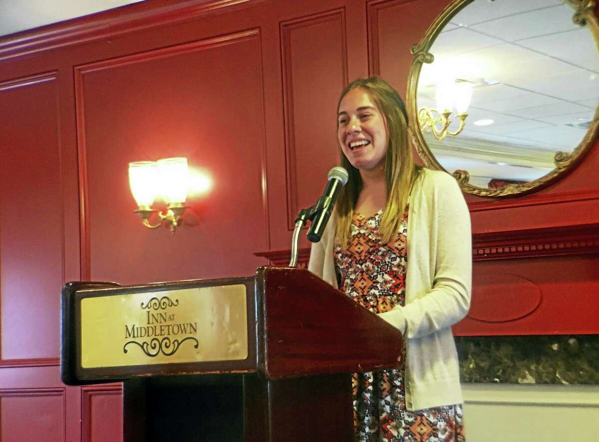 East Hampton High School senior Alyssa Mercaldi accepts a $1,000 scholarship from the Middlesex County Bar Association on Friday for an essay she wrote on the Miranda Warning.