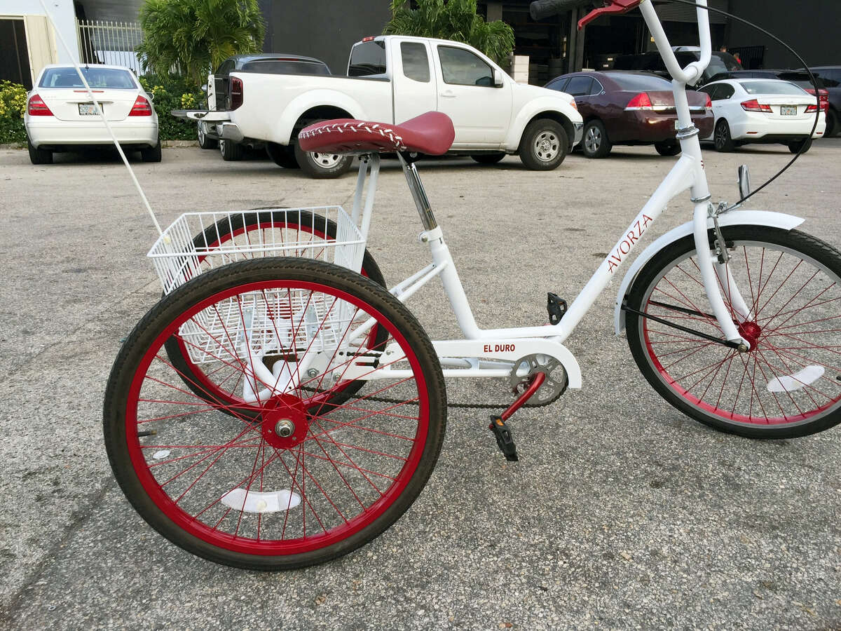 A custom made three-wheel bicycle is shown outside The Auto Firm in Doral, Fla. Yoenis Cespedes' newest custom ride is a definite throwback. The New York Mets outfielder, whose car collection drew headlines early in spring training, now has a custom three-wheel bicycle similar to the one he had in Cuba.