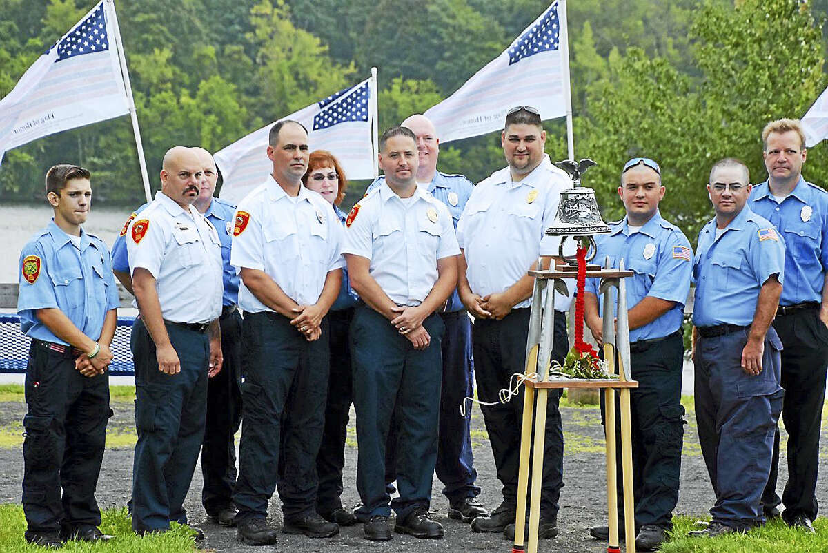 Cromwell first responders surround the 15th anniversary of the 9/11 attacks.
