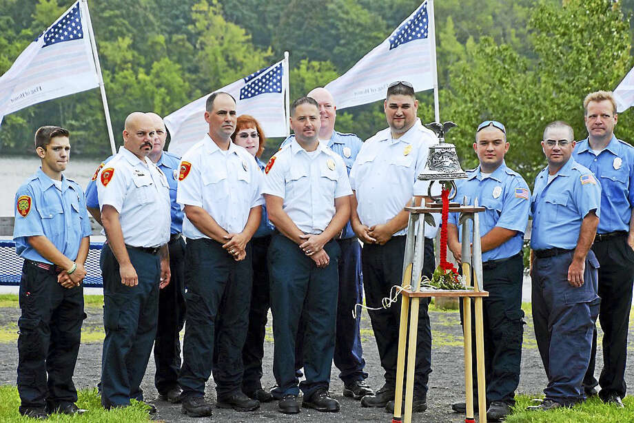 Cromwell first responders surround the 15th anniversary of the 9/11 attacks. Photo: Jeff Mill — The Middletown Press