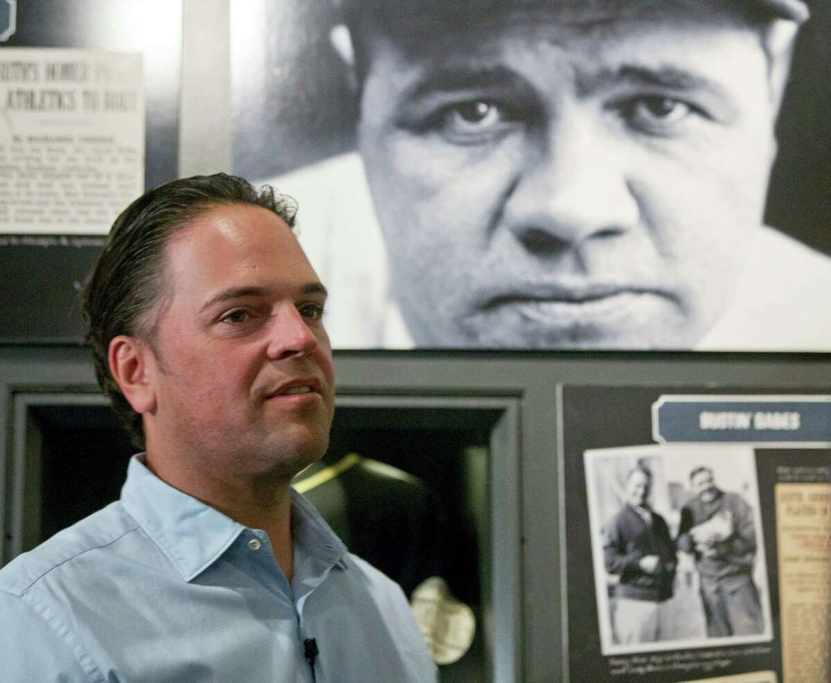 Baseball Hall of Fame electee Mike Piazza visits a Babe Ruth exhibit during his orientation tour on Tuesday in Cooperstown, N.Y. Piazza will be inducted in July.