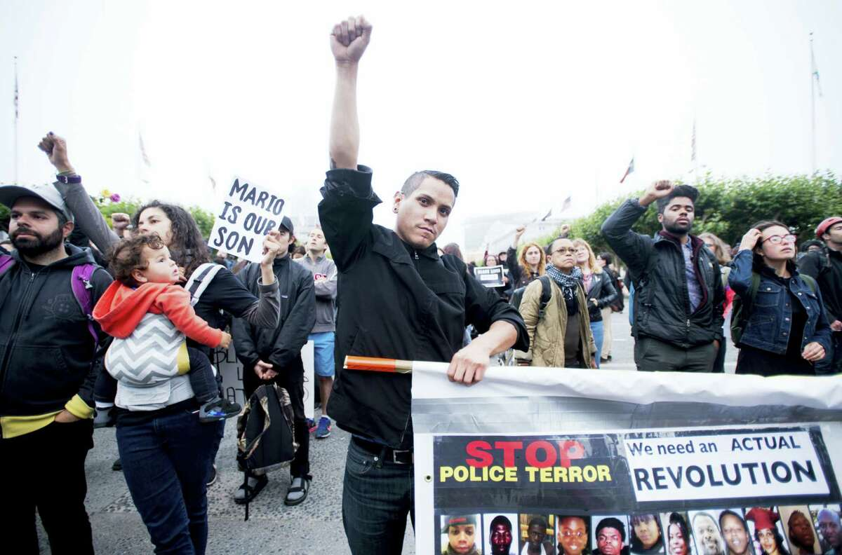 Protesters rally against the recent fatal shootings by police of black men in San Francisco on Friday, July 8, 2016. The peaceful group marched about two miles to San Francisco City Hall.