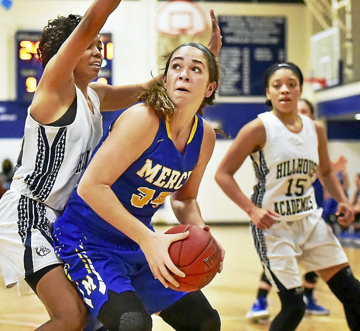 Mercy's Samantha Gallo makes a move around Hillhouse defenders in a victory earlier this season. Mercy remains the second-ranked team as it heads to East Haven with a perfect record Monday.