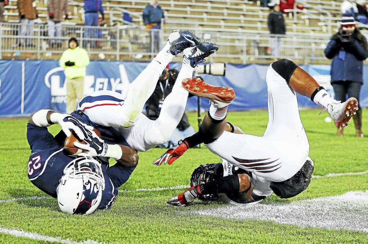 UConn safety Junior Lee (23) pulls in an interception during a 2014 game against Cincinnati.
