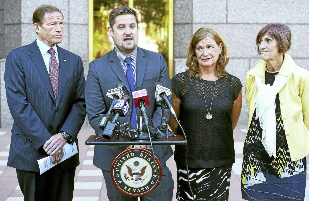 U.S. Sen. Richard Blumenthal, left, and U.S. Rep. Rosa DeLauro, right, joined Brett Eagleson, center left, and his mother, Gail Eagleson, center right, at a press conference in New Haven on Monday to advocate for President Barack Obama to sign the Justice for Victims of Terrorism Act. Brett's father and Gail's husband, Bruce Eagleson, was one of 161 victims with Connecticut ties killed in the terrorist attacks of Sept. 11, 2001.