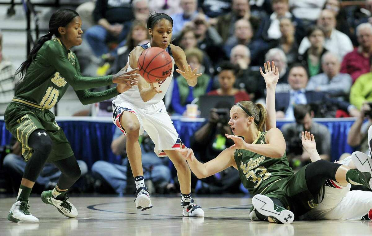 UConn's Moriah Jefferson, center, intercepts a pass for a steal against South Florida in Monday night's AAC championship game in Uncasville.