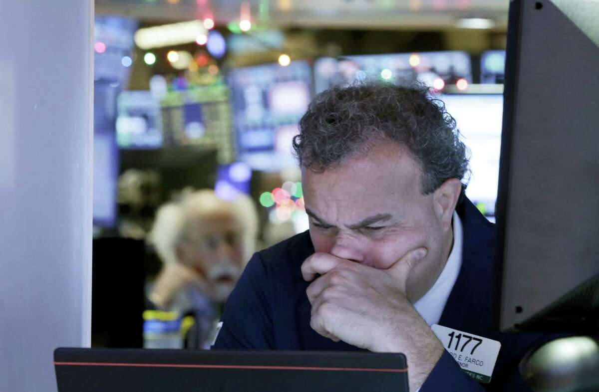 Trader Gerard Farco works on the floor of the New York Stock Exchange Monday.