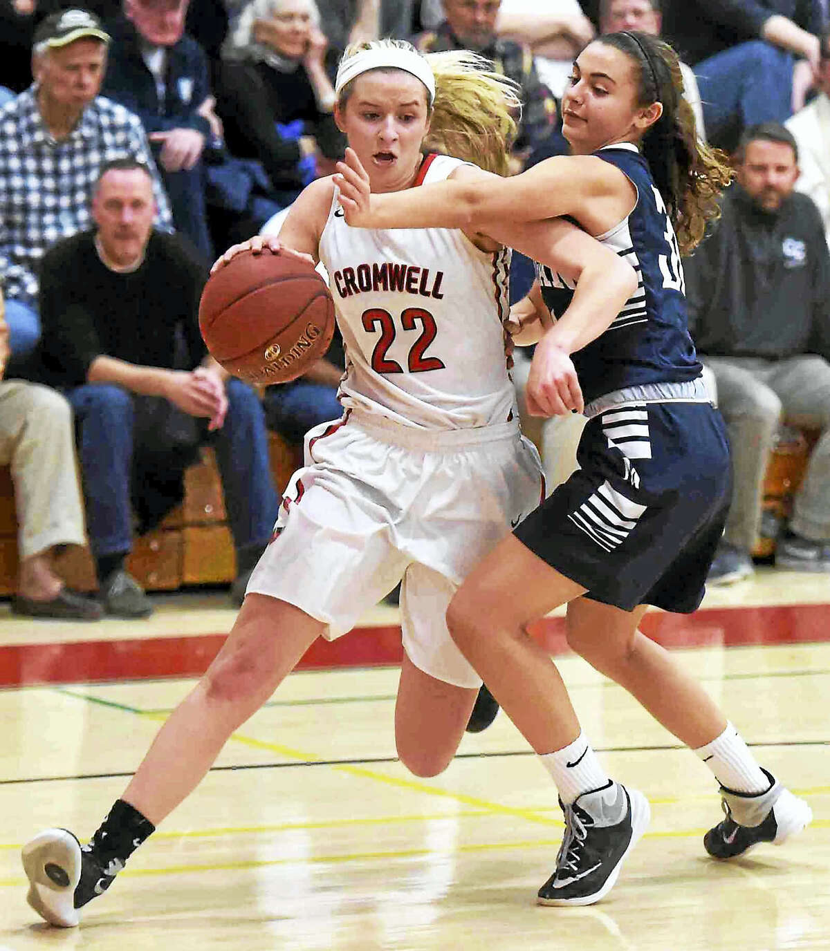 Araya Lessard of Cromwell High School tries to move the ball down court Monday against Brianna Navarra of Morgan during the second quarter of the CIAC Class M Girls basketball quarterfinal in Cromwell.