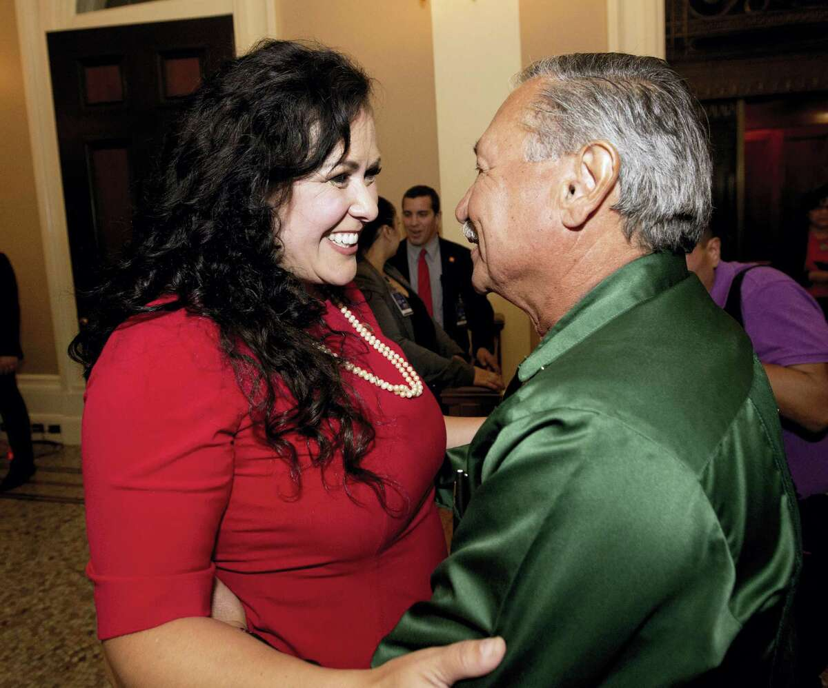 Assemblywoman Lorena Gonzalez, D-San Diego, receives congratulations from Arturo Rodriguez, president of the United Farm Workers, after the Assembly approved her bill requiring farmworkers to receive overtime pay after working eight hours, at the Capitol, in Sacramento Calif.