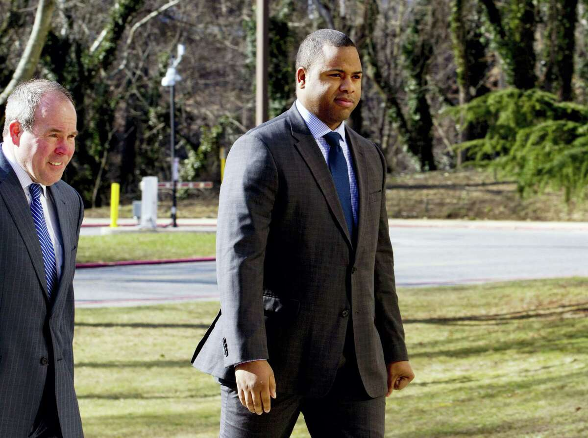 In this March 3, 2016, file photo, Officer William Porter, right, one of six Baltimore city police officers charged in the death of Freddie Gray, arrives to Maryland Court of Appeals in Annapolis, Md. Maryland's highest court has ruled on Tuesday, March 8, 2016, that Porter must testify against his colleagues while he awaits retrial.