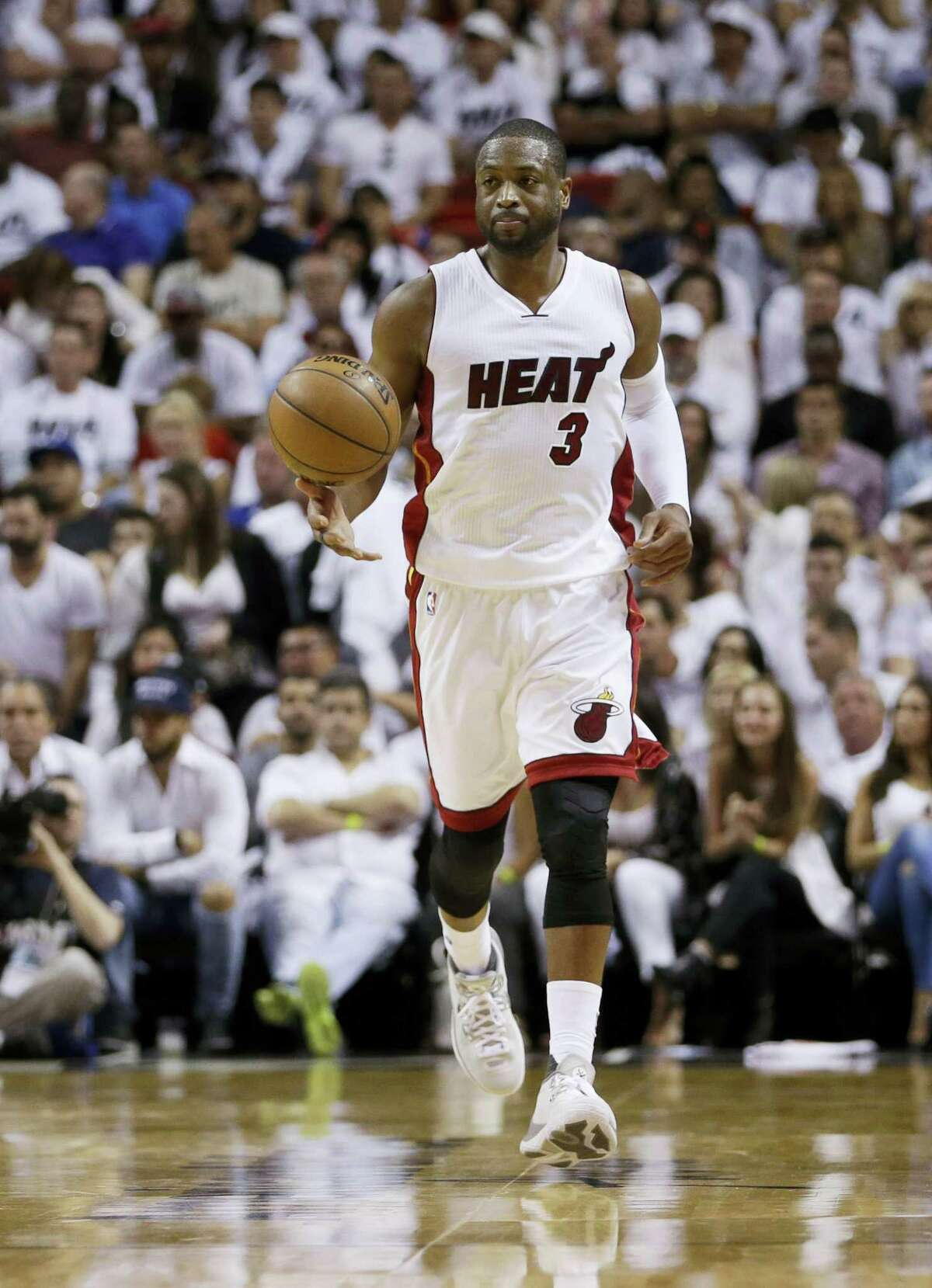 Miami Heat guard Dwyane Wade dribbles up the court during Game 3 against the Raptors on Saturday.