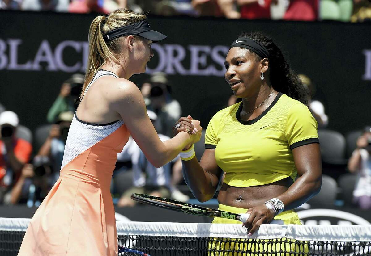 """In this Jan. 26, 2016, file photo, Serena Williams, right, of the United States is congratulated by Maria Sharapova of Russia after winning their quarterfinal match at the Australian Open tennis championships in Melbourne, Australia. Serena Williams says Maria Sharapova """"showed a lot of courage"""" in taking responsibility for her failed drug test. The 21-time major champion said Tuesday, March 8, 2016, she """"hoped for the best"""" for Sharapova, a day after the Russian star revealed she failed a test the day she lost to Williams at the Australian Open in January."""