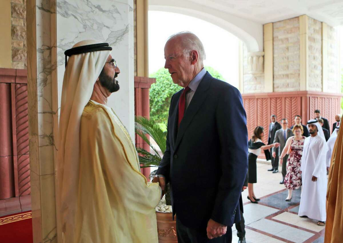 U.S. Vice President Joe Biden, shakes hands with Sheikh Mohammed Bin Rashid Al Maktoum, ruler of Dubai and UAE Vice President after his arrival in Dubai, United Arab Emirates on March 8, 2016.