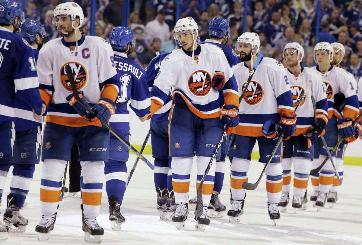 Members of the New York Islanders congratulate the Tampa Bay Lightning at the end of Game 5 of the Eastern Conference semifinals on Sunday. The Lightning advanced to the Eastern Conference finals.
