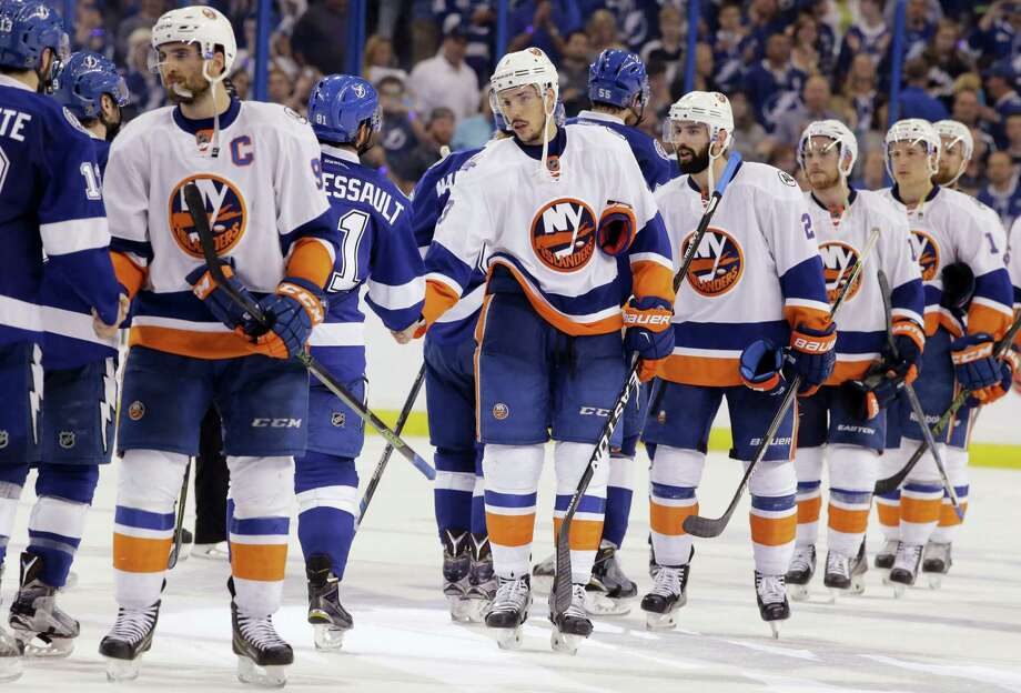 Members of the New York Islanders congratulate the Tampa Bay Lightning at the end of Game 5 of the Eastern Conference semifinals on Sunday. The Lightning advanced to the Eastern Conference finals. Photo: Chris O'Meara — The Associated Press  / AP