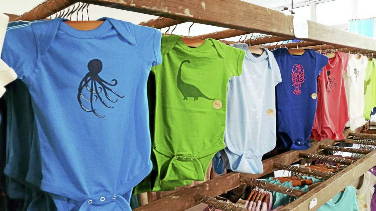 Colorful onesies for little ones and tee shirts galore greet shoppers as they enter Cinder + Salt.