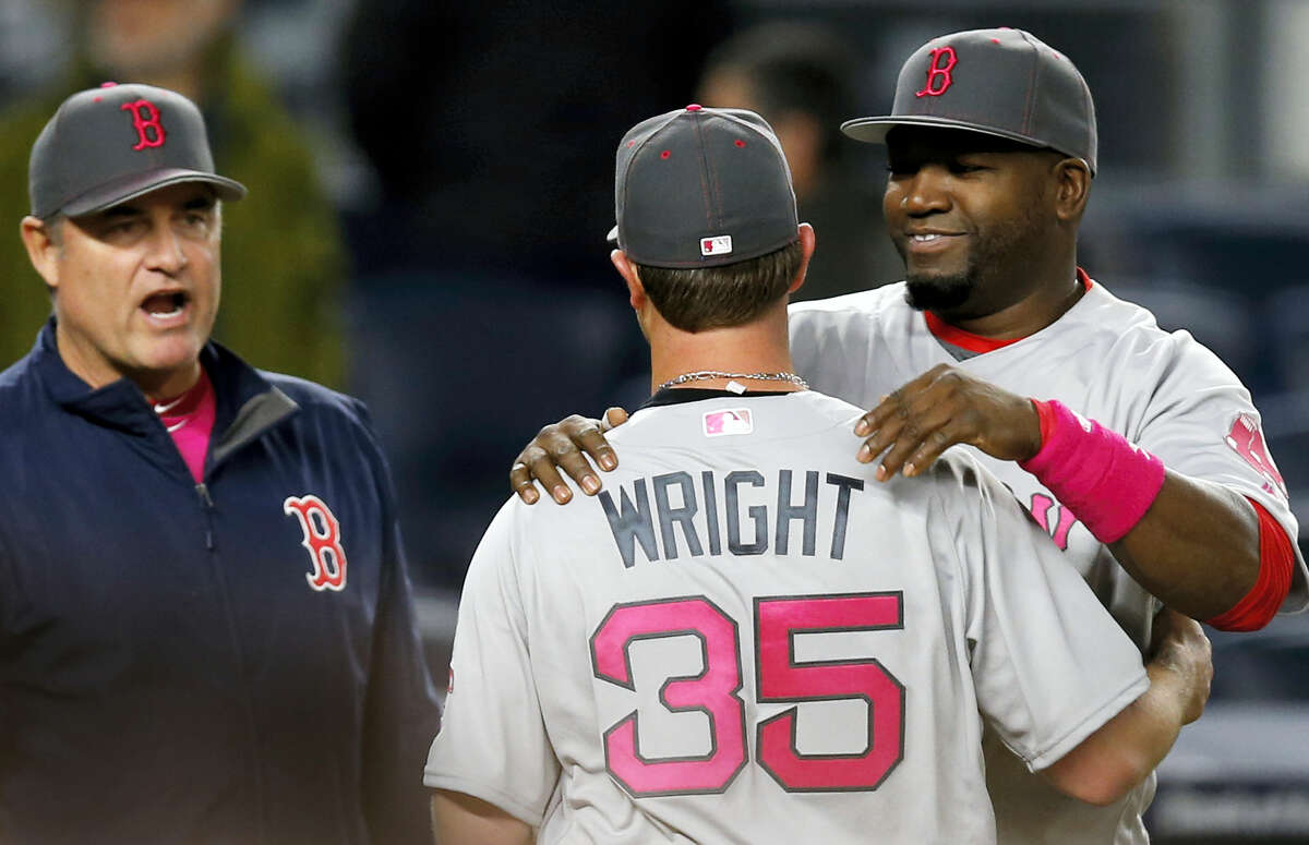 Red Sox manager John Farrell, left, and designated hitter David Ortiz, right, congratulate Steven Wright after Sunday's game. Wright allowed just three hits in a 5-1 win over the Yankees.