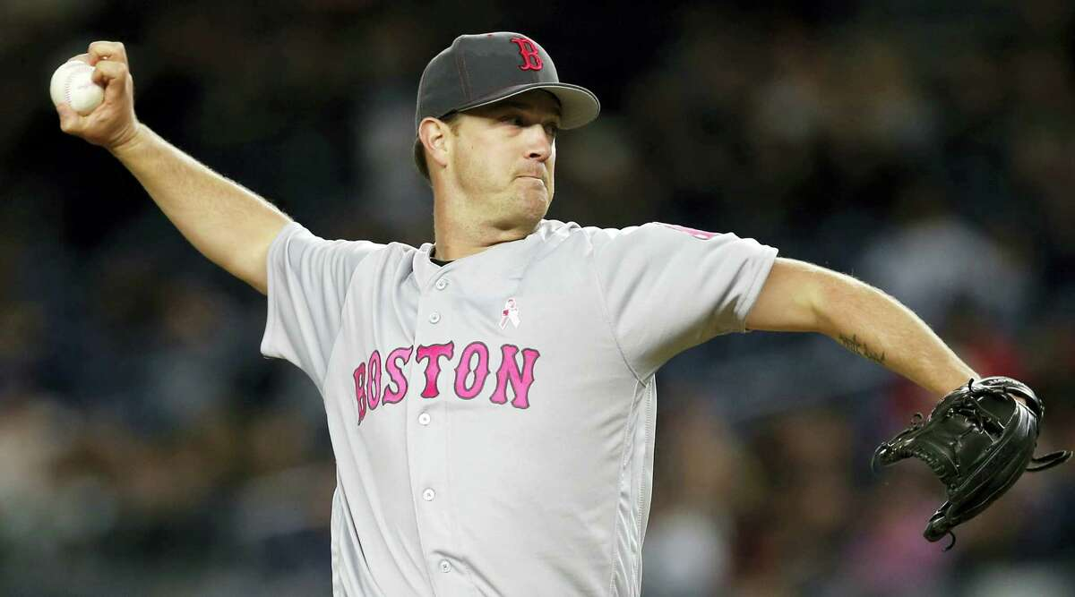 Steven Wright delivers a pitch during the first inning on Sunday.