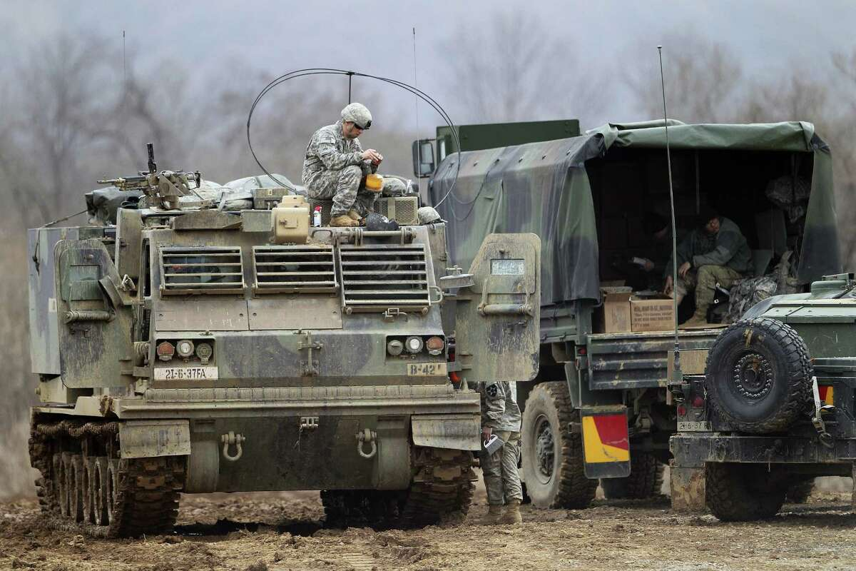 """A U.S. Army soldier sits on an armored vehicle during an annual exercise in Yeoncheon, near the border with North Korea, Monday, March 7, 2016. North Korea on Monday issued its latest belligerent threat, warning of an indiscriminate """"pre-emptive nuclear strike of justice"""" on Washington and Seoul, this time in reaction to the start of huge U.S.-South Korean military drills."""