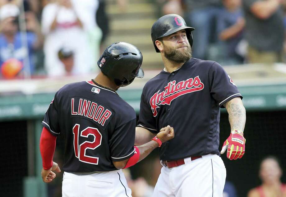 The Indians' Mike Napoli, right, is greeted by Francisco Lindor after hitting a home run in the third inning Friday. Photo: Aaron Josefczyk — The Associated Press  / FR171101 AP