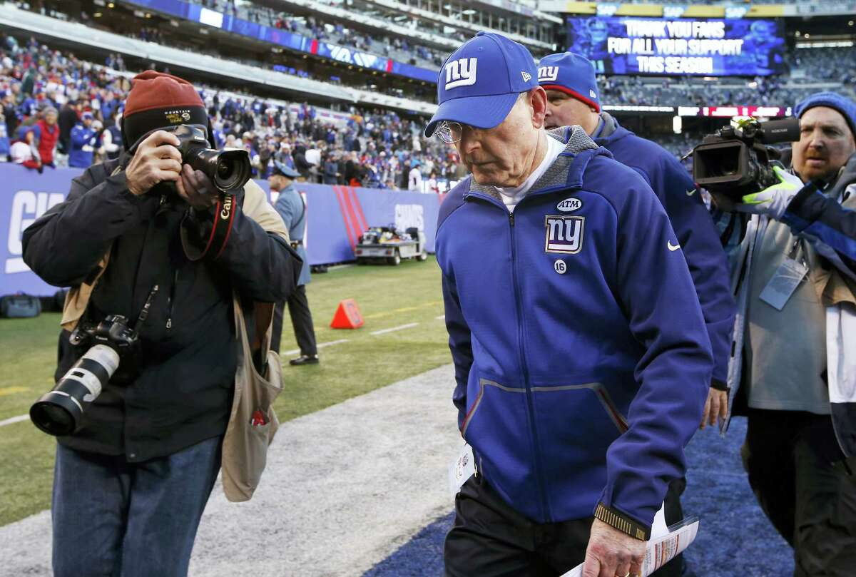 Giants head coach Tom Coughlin walks off the field after losing to the Eagles on Sunday.