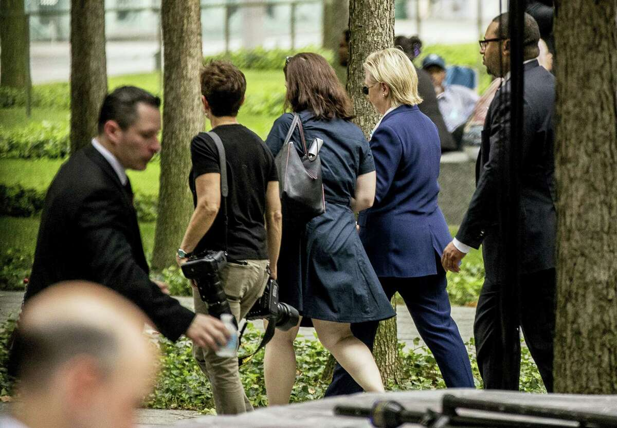 Democratic presidential candidate Hillary Clinton, second from right, departs after attending a ceremony at the Sept. 11 memorial, in New York on Sept. 11, 2016 on the 15th anniversary of the Sept. 11 attacks.