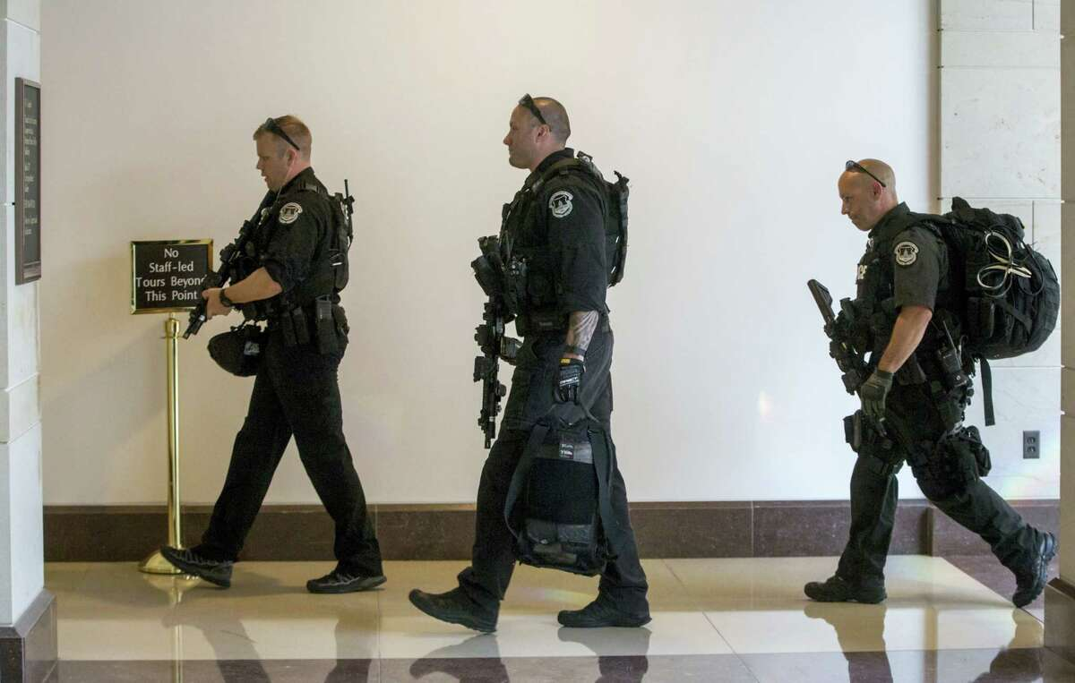 Capitol Police return to their stations as an emergency lockdown was lifted on Capitol Hill in Washington on Friday.
