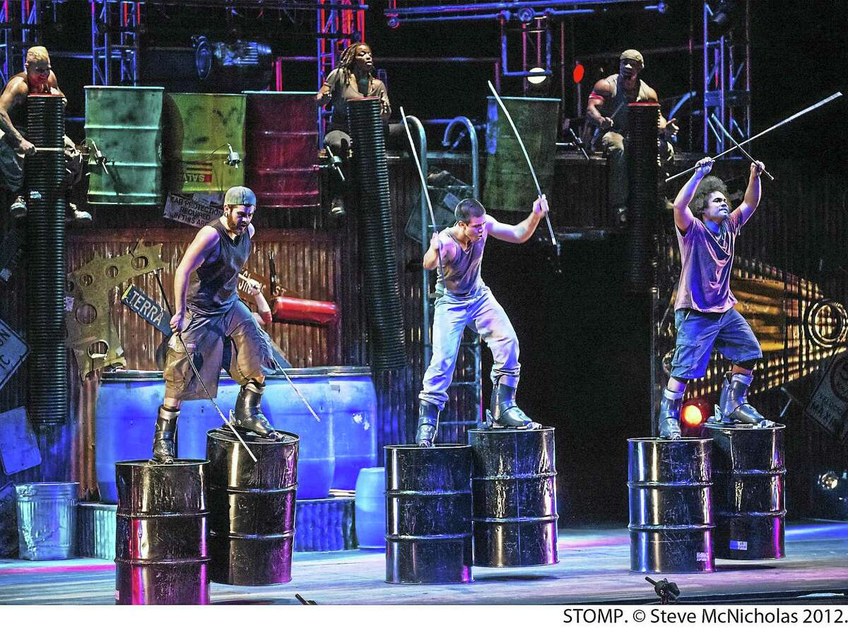 """Barrel walkers in a scene from """"Stomp."""""""