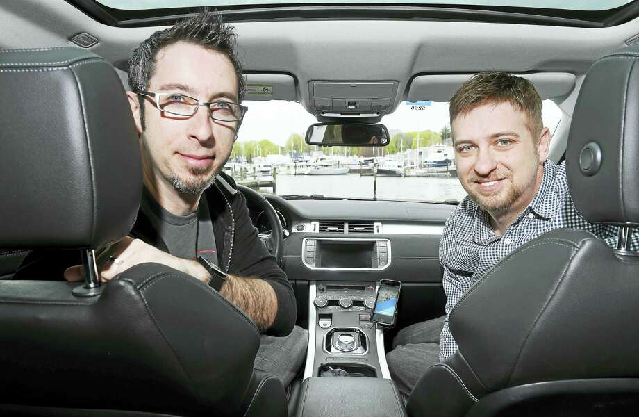 (Arnold Gold-New Haven Register)  Stephen Barrante, left, and Rob Kurfehs, shown in Milford recently, created a scenic navigation app, Round, for the iPhone that enables users to both find and record scenic driving and walking routes. Photo: Journal Register Co.