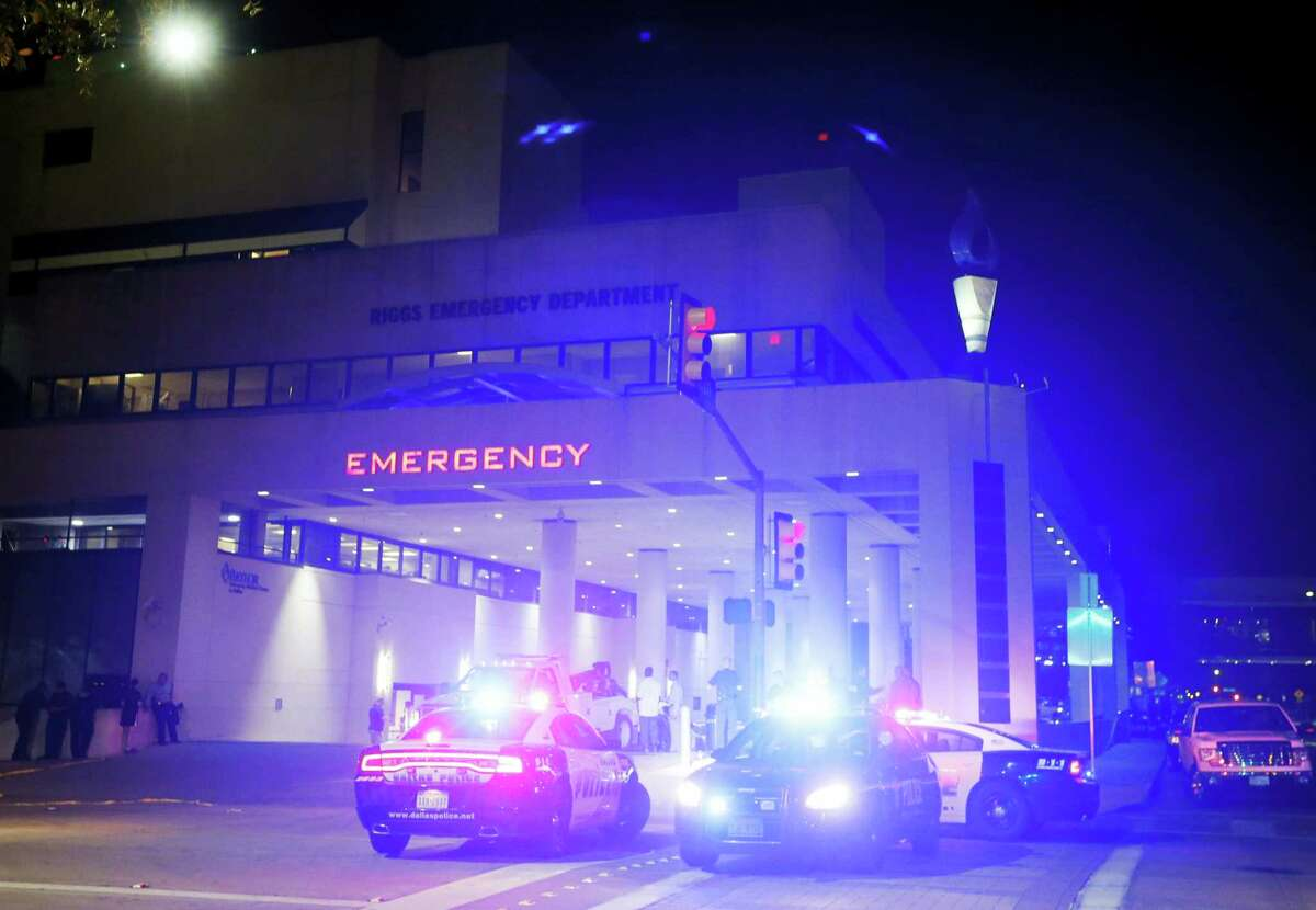 Emergency responder vehicles sit outside of the emergency room at Baylor University Medical Center, Friday, July 8, 2016, in Dallas.