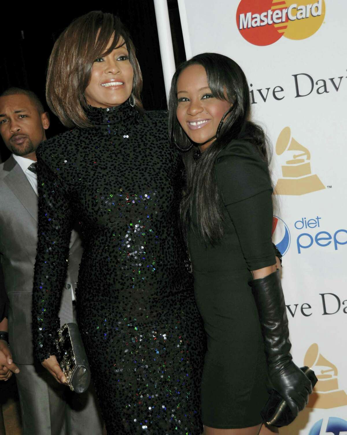 In this Feb. 12, 2011 photo, singer Whitney Houston, left, and daughter Bobbi Kristina Brown arrive at the Pre-Grammy Gala & Salute to Industry Icons with Clive Davis honoring David Geffen in Beverly Hills, Calif.