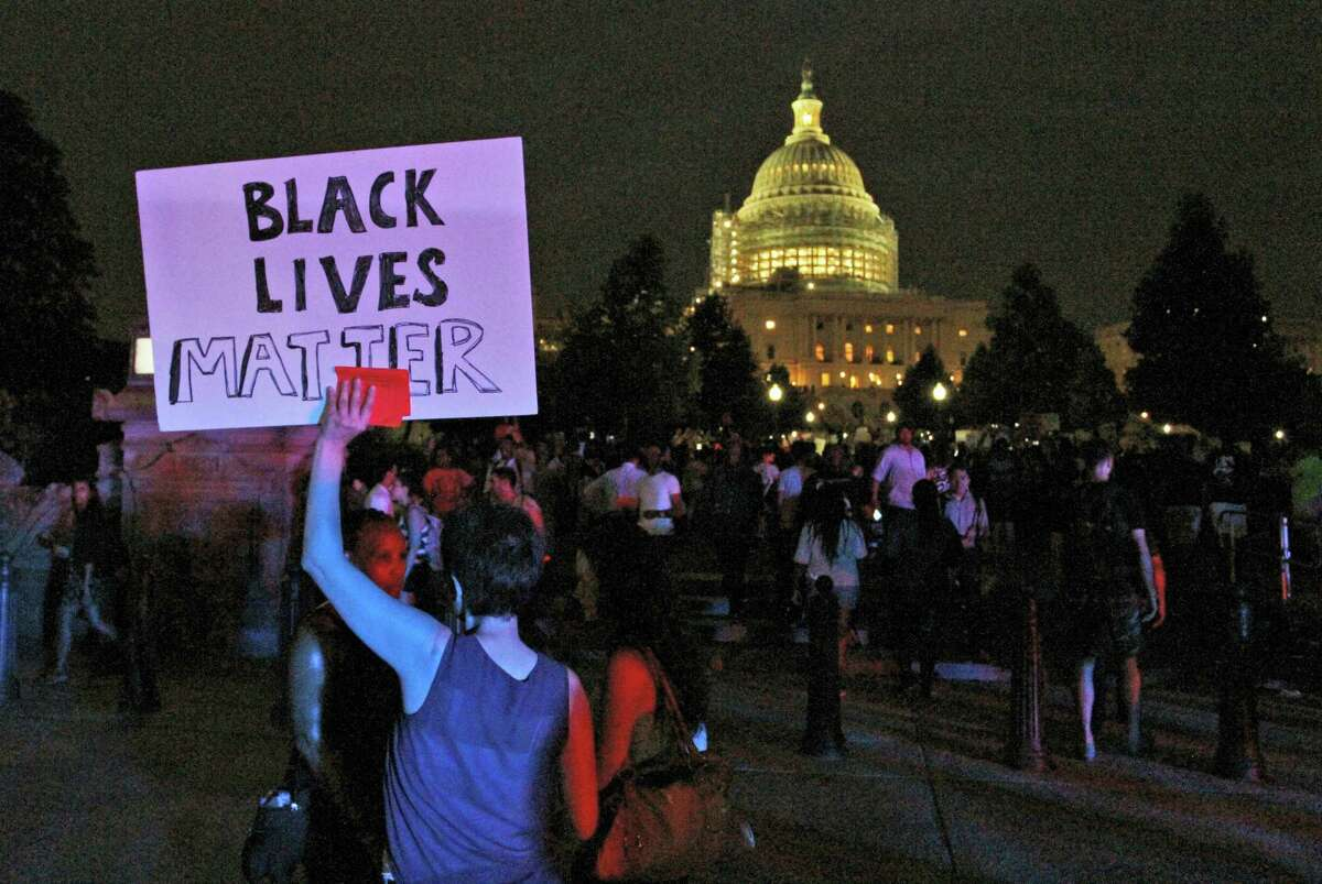 A Black Lives Matter sign is held up near the Capitol as a protest march about police brutality arrived after having started near the White House, Thursday, July 7, 2016, in Washington.