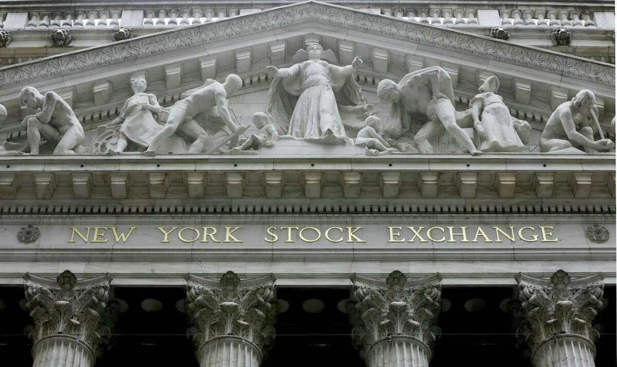 FILE - This Thursday, Oct. 2, 2014, file photo, shows the facade of the New York Stock Exchange. Global stocks slipped on Tuesday, March 8, 2016, amid renewed concern about China, which reported sharply weaker trade figures for February. The price of oil and other commodities stabilized after strong gains the day before.