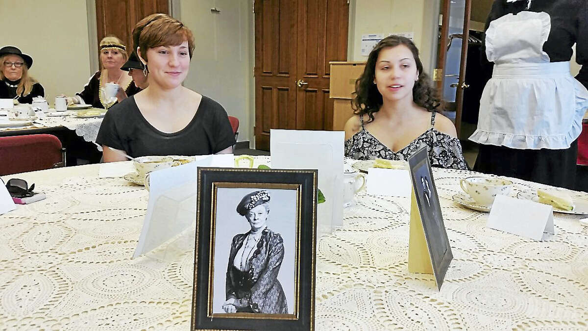 """Megan Porga, 16, and Meghan Conlin, 16, dined under the watchful eyes of a photo of the Dowager Countess of Grantham (played by Dame Maggie Smith) at the """"Downton Abbey"""" Tea Party at the Burlington Public Library at 34 Library Lane in Burlington on Saturday afternoon."""