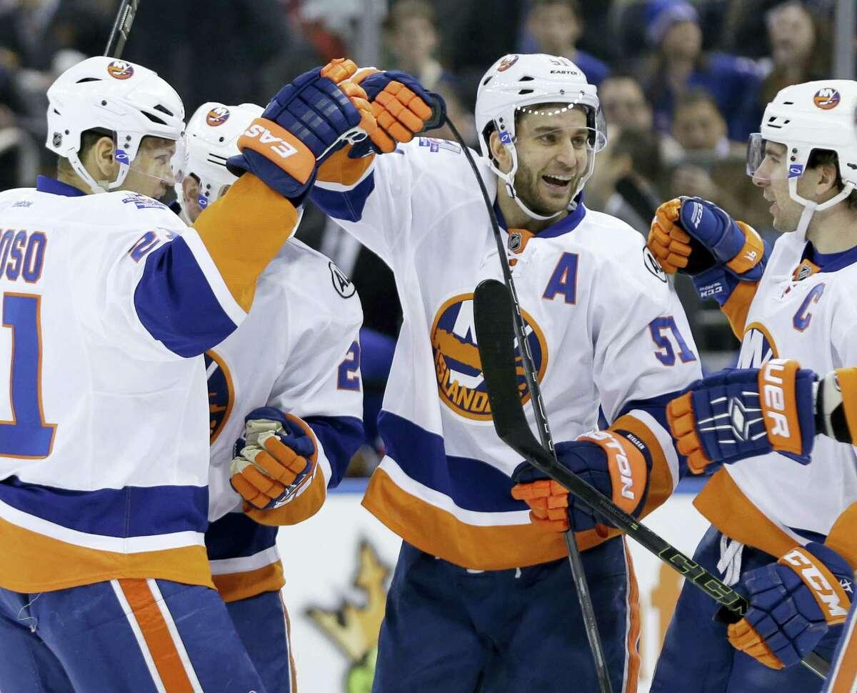 New York Islanders' Frans Nielsen, center, celebrates a goal by teammate Nick Leddy Sunday.