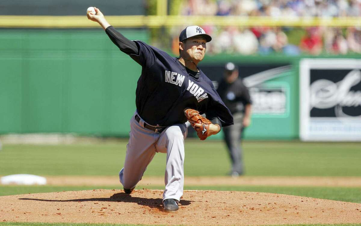 New York Yankees' Masahiro Tanaka throws during the first inning of a spring training baseball game against the Philadelphia Phillies on Sunday, March 6, 2016, in Clearwater, Fla. (AP Photo/Mike Carlson)