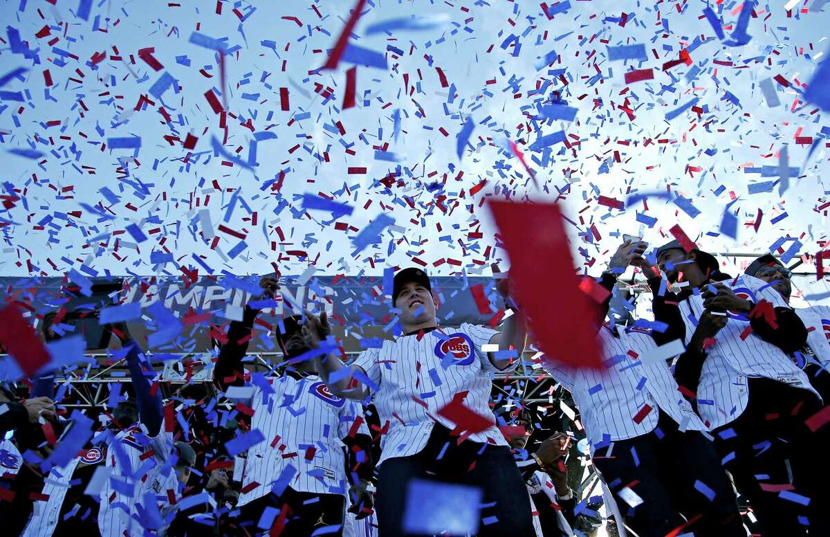 Chicago cubs players celebrate during a celebration honoring the World Series champions at Grant Park in Chicago on Nov. 4, 2016.