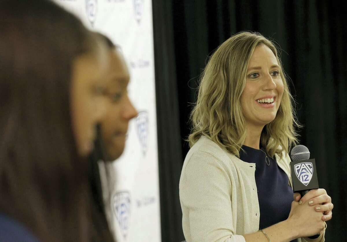 California head coach Lindsay Gottlieb, right, speaks during the Pac-12 NCAA college basketball media day.