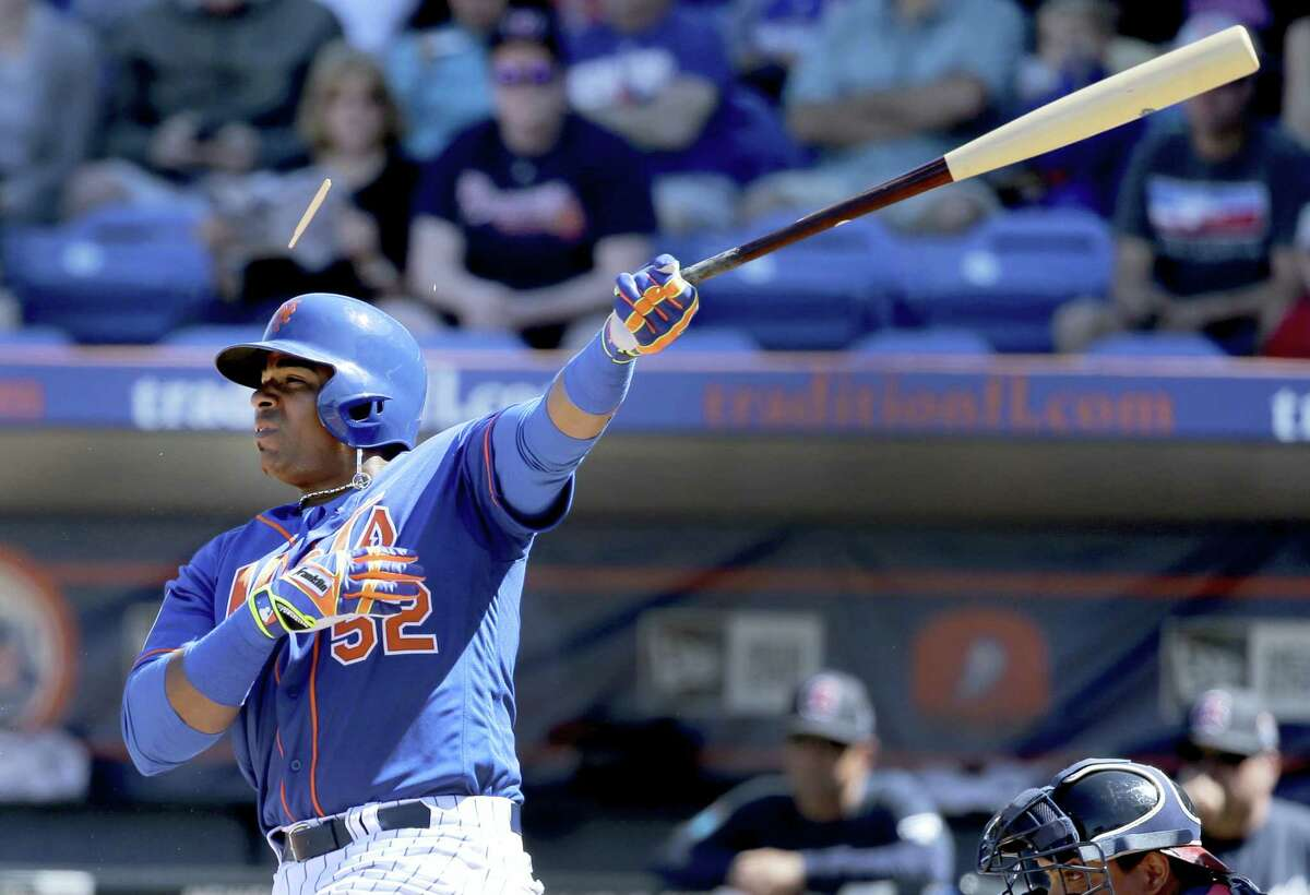 New York Mets' Yoenis Cespedes splinters his bat while hitting an RBI-single during the first inning of an exhibition spring training baseball game against the Atlanta Braves, Sunday, March 6, 2016, in Port St. Lucie, Fla. (AP Photo/Jeff Roberson)