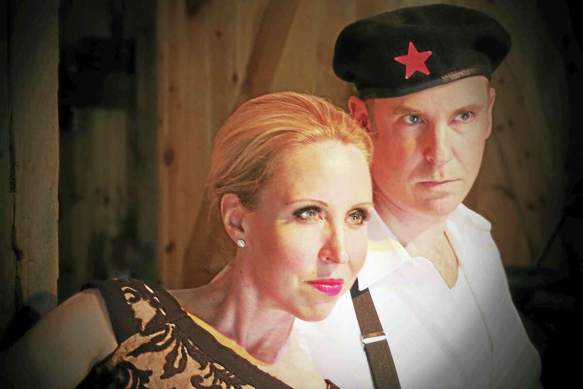 "Carly Callahan as Eva Peron and John Johmann as Che Guevara in ""Evita."""