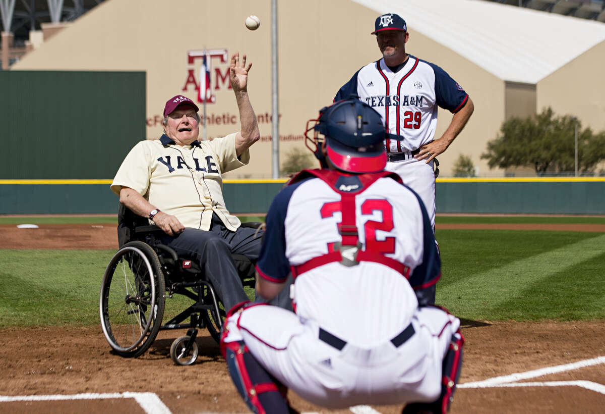 Former President George H. W. Bush throws out an opening pitch to Texas A&M player Stephen Kolek before a college baseball game between Texas A&M and Yale on March 5, 2016 in College Station, Texas.